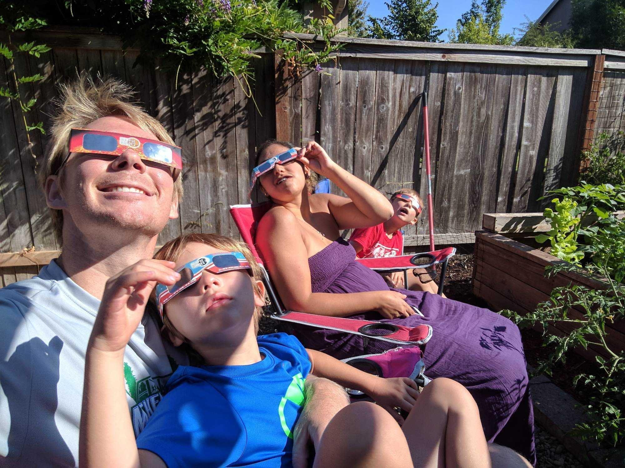 zeth watching solar eclipse with family
