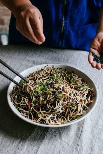 sprinkling seaweed on noodles
