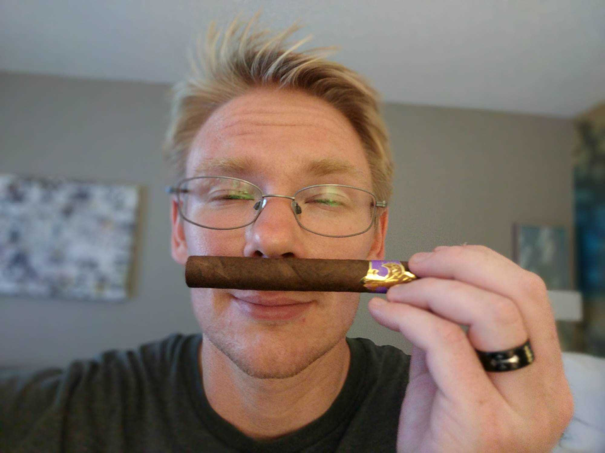 zeth holding cigar
